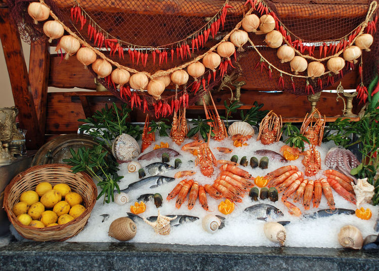 High angle view of frozen fish in container for sale at market