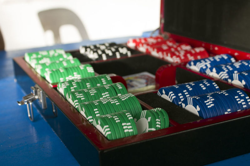 Close-Up Of Gambling Chips On Table