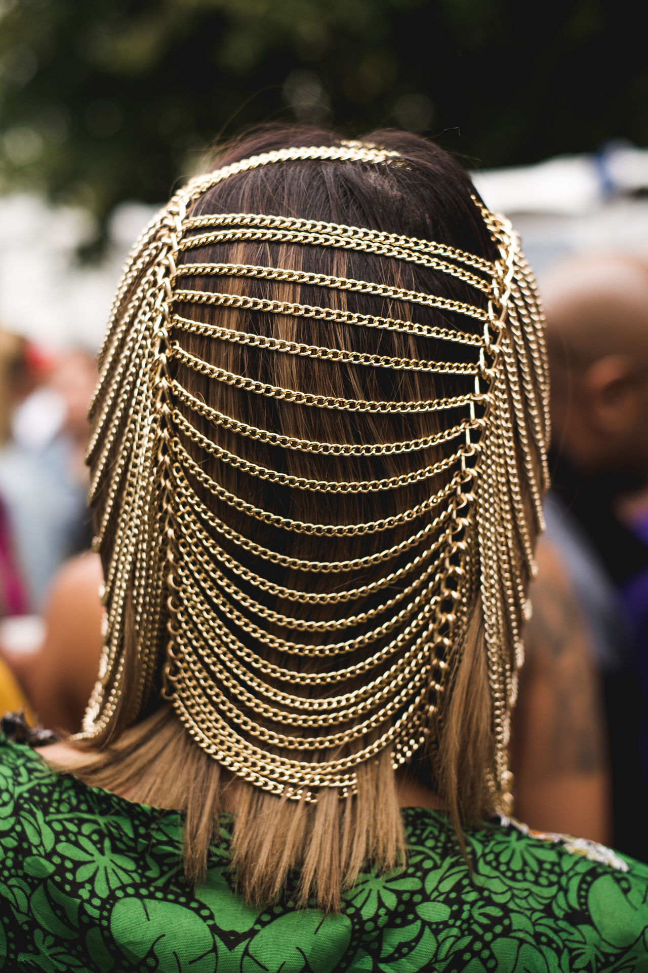 Rear view of woman wearing jewelry on head
