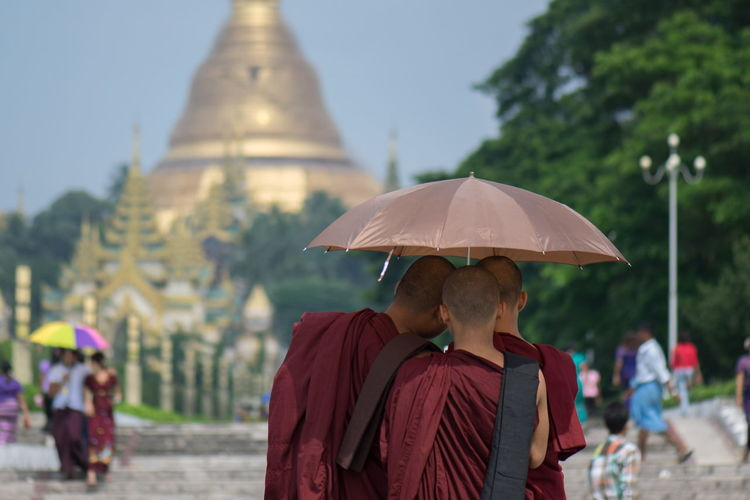monks at shwedagon pagoda Cultures Heat Monk  Monks Myanmar Pagoda Rangoon Rear View Shadow Shwedagon Tourism Umbrella Yangon