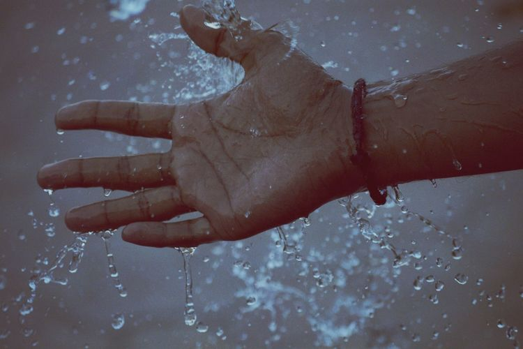Cropped image of wet hand during monsoon