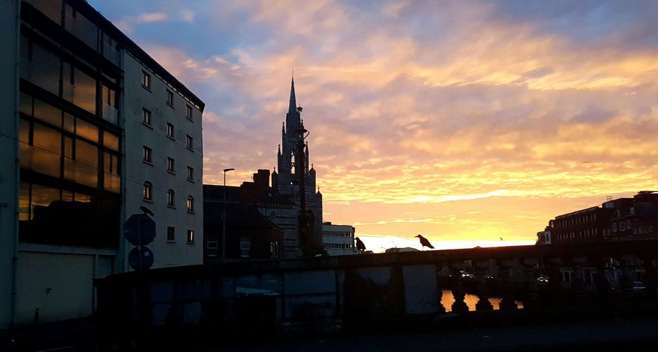 Beautiful sky this morning No Filter, No Edit, Just Photography The Week On EyeEm Architecture Water Silhouette City Landscape Sunrise In The City Dramatic Skies EyeEm Sunrise Shots No People Silhoutteshadows 🌇 Silhoutte Of Bird Dramatic Sky Reflections In The Glass Windows Church Steeple Church Silhouettes