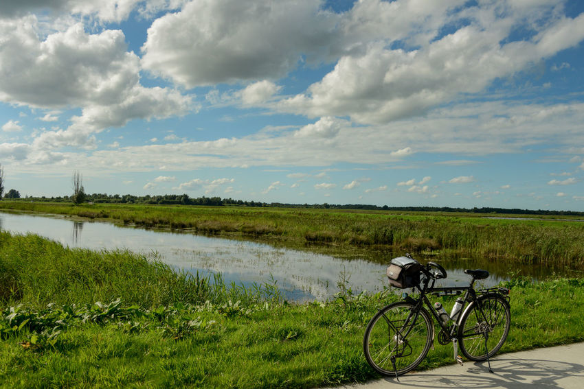 Waterland cycle route in Overijssel, Holland Bicycle Trip Netherlands Overijssel The Netherlands Waterland Fietsroute Weerribben Weerribben Wieden Bicycle Cloud - Sky Day Grass Holland Landscape Mode Of Transport Nature No People Outdoors Scenics Sky Tranquil Scene Tranquility Transportation Water Waterland