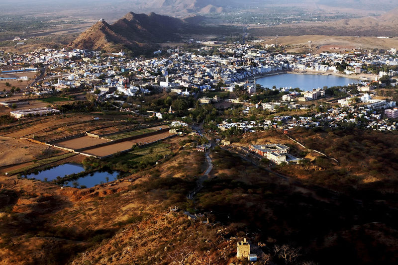 Aerial View Of Lake Amidst Houses In Pushkar By Mountain