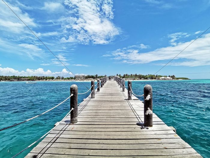 The tranquil blue waters of Lakawon Water Sky The Way Forward Pier Direction Day Sea Wood - Material Cloud - Sky Nature Beauty In Nature Sunlight Diminishing Perspective Blue Scenics - Nature Tranquility Wood