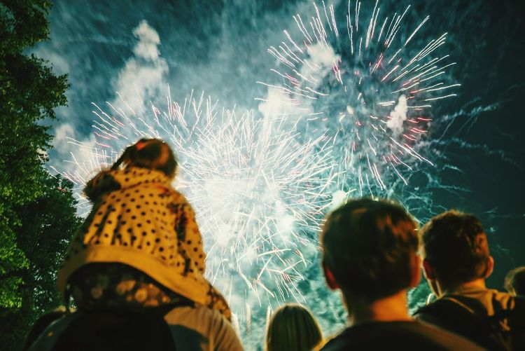 Celebration Night Firework Display Event Rear View Adult Watching People Multi Colored Lifestyles Togetherness Women Men Outdoors Illuminated Defocused Adults Only Sky Close-up Fresh On Market 2017