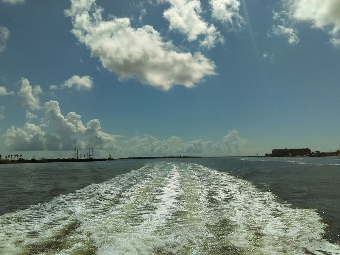 A Wake Behind The Boat On A Job Ocean View Between Islands Waves And Sways Clouds And Sky Gulf Of Mexico