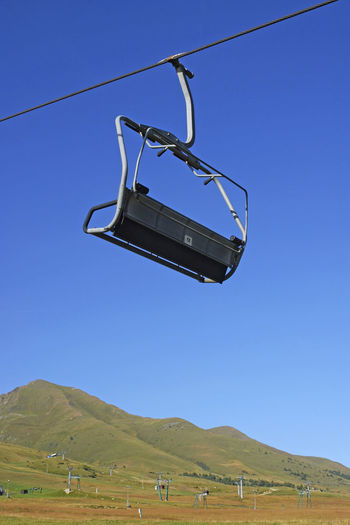 chair lift and mountain landscape in the summer, Passo del Tonale, Italy Ski Lift Chair Lift Chairlift Skilift Hanging Tonale Italy Alps Sky Blue Nature Clear Sky Landscape Mountain Environment Non-urban Scene Transportation No People Scenics - Nature Cable Car Mountain Range Travel Absence Stationary
