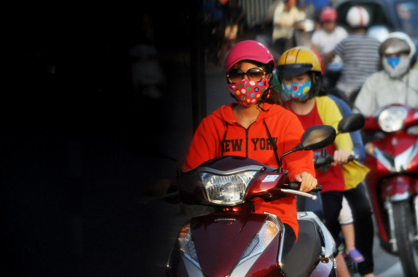 Motorscooter traffic in street in Hue Imperial City, Vietnam. Facemasks Focus On Foreground Helmets Huế Lifestyles Motorcycles Motorscooters Red Selective Focus Street Traffic Vietnam Vietnamese