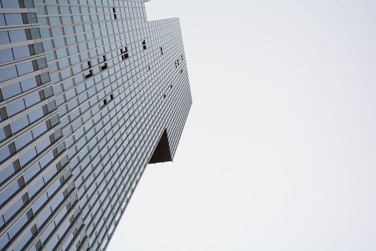 In need of some fresh air! Architecture Building Building Exterior Built Structure City Clear Sky Copy Space Day Directly Below Low Angle View Modern Nature No People Office Office Building Exterior Open Windows Outdoors Pattern Sky Skyscraper Tall - High Tower