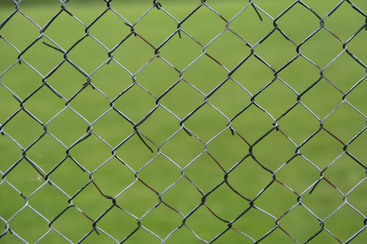 Abstract Backgrounds Chainlink Fence Danger Fence Focus On Foreground Full Frame Geometry Green Metal No People Outdoors Pattern Protection Safety Security Simplicity Showing Imperfection