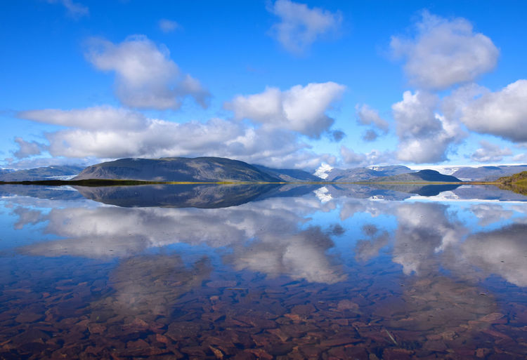 Reflection in Iceland Beauty In Nature Blue Cloud - Sky Day Floating On Water Lake Landscape Mountain Nature No People Outdoors Reflection Scenics Sky Tranquil Scene Tranquility Water