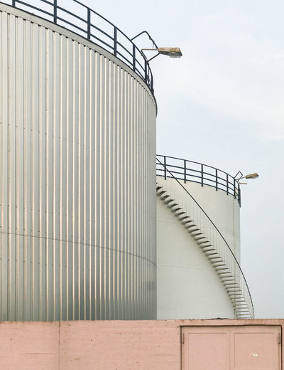 Storage tank against sky