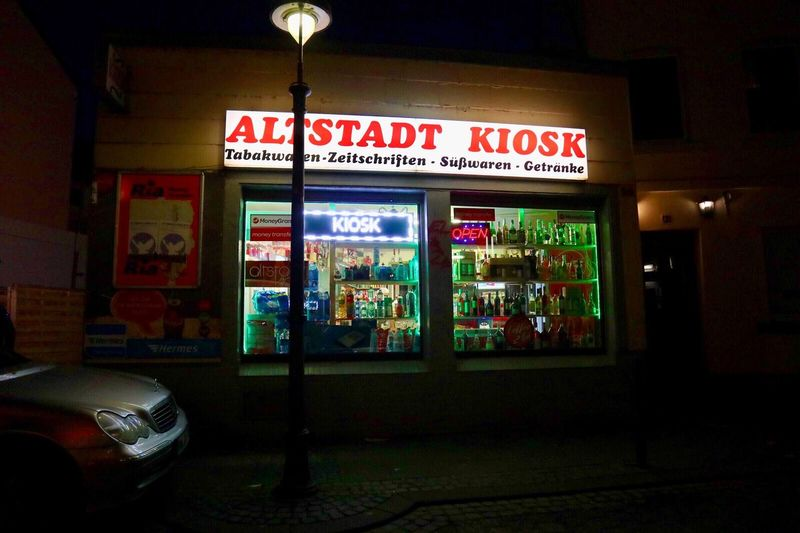 Kiosk Text Communication Architecture Illuminated Western Script Night Arts Culture And Entertainment No People Built Structure Wall - Building Feature Mode Of Transportation Building Exterior Entrance Sign Transportation Neon City Nightlife Food And Drink
