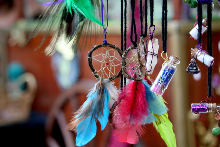 Close-Up Of Multi Colored Dreamcatcher Hanging For Sale In Market
