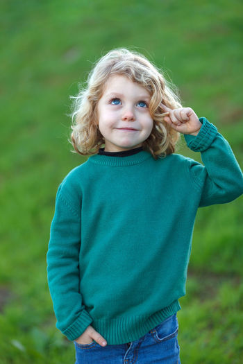 Portrait of cute girl standing on land