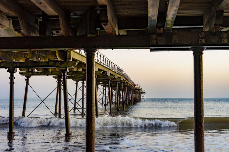 Saltburn pier. England. Water Sea Architecture Built Structure Pier Horizon Over Water Sky No People Horizon Nature Scenics - Nature Outdoors Saltburn Saltburn By The Sea Piers England Teesside Yorkshire North East England Architectural Column Beach Underneath Connection Wood - Material Wooden Post