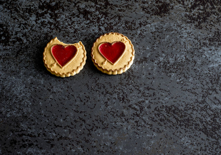 High angle view of cookies with heart shape on table