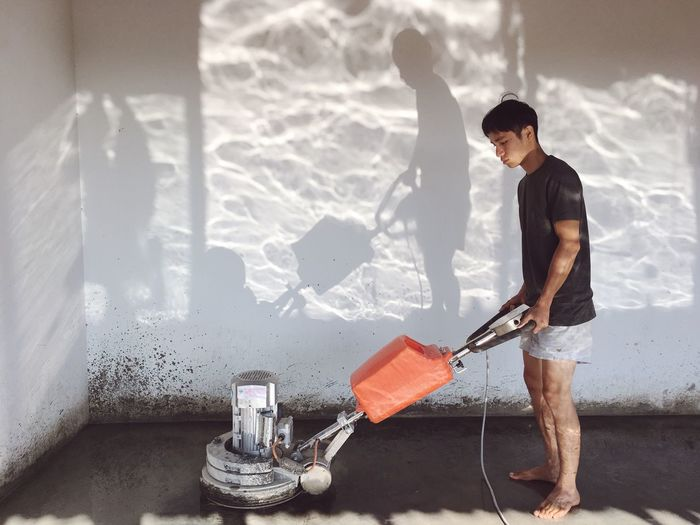 Cool workplace One Person Holding Real People Full Length Shadow Day Paint Roller Outdoors Adult Young Adult People