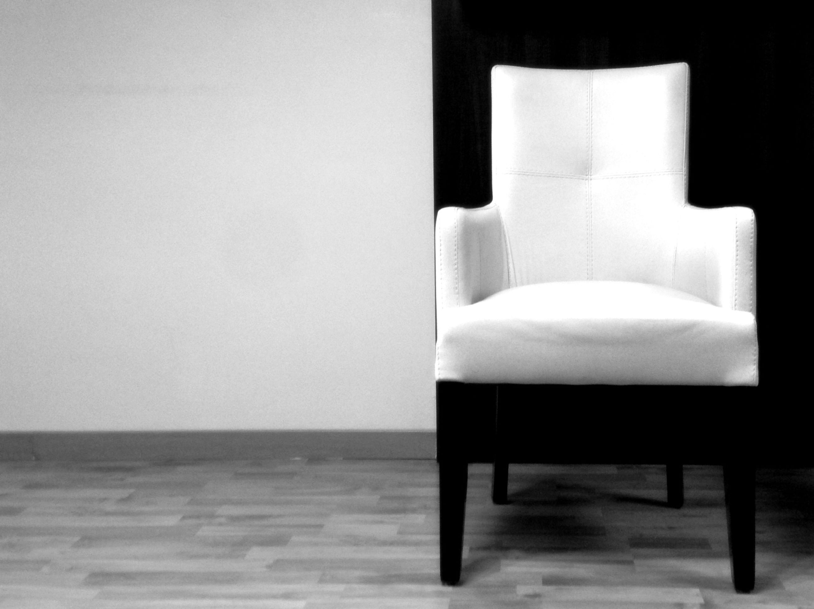 indoors, copy space, empty, table, chair, absence, white color, home interior, wall - building feature, white, wall, no people, still life, flooring, furniture, wood - material, seat, shadow, simplicity, lighting equipment