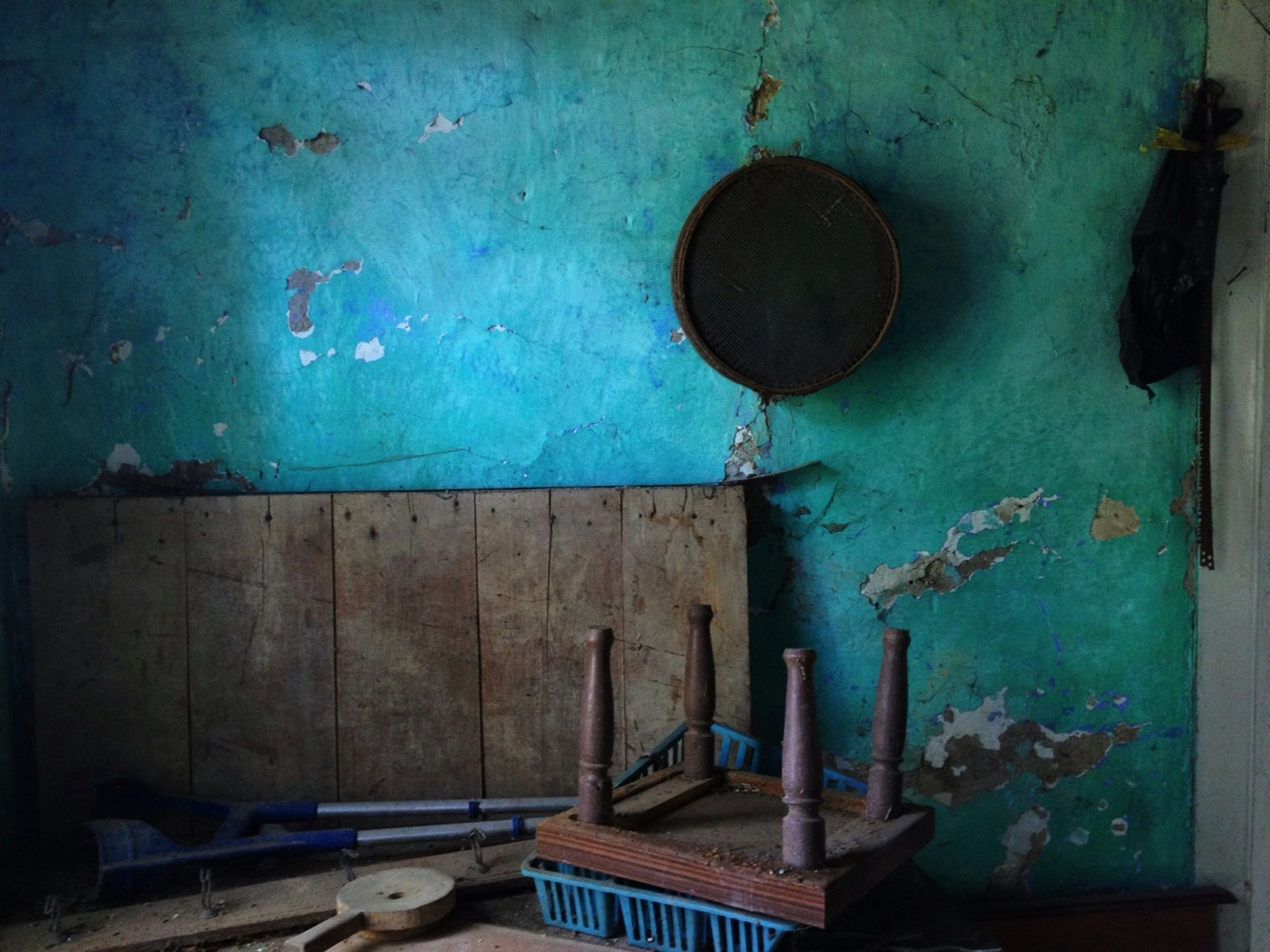 indoors, abandoned, old, wall - building feature, built structure, wall, deterioration, damaged, run-down, architecture, obsolete, door, messy, weathered, no people, metal, house, blue, absence, close-up