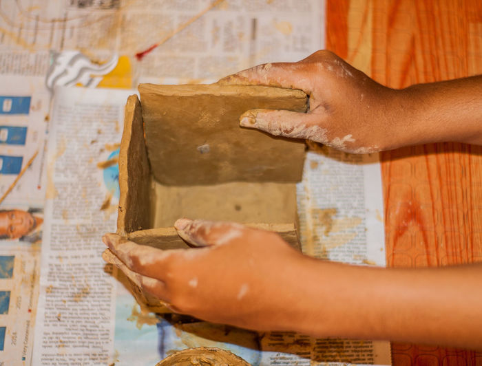 Cropped hand of craftsperson pottery art