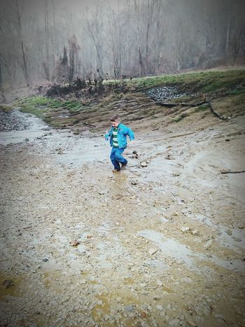 My Lil Man Enjoying Life Playing In The Rain On The River Bank