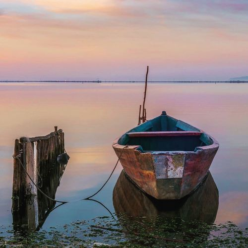 Water Nautical Vessel Transportation Tranquility Moored Nature Sky Sunset Mode Of Transport Boat Tranquil Scene Beauty In Nature Outdoors Sea Scenics No People Floating On Water Day