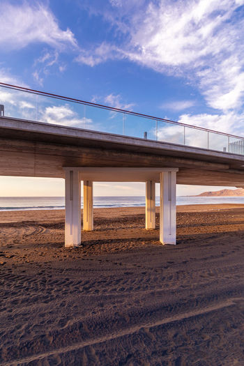 Sky Cloud - Sky Architecture Built Structure Land Connection Nature Bridge Transportation Sand Bridge - Man Made Structure No People Day Sunlight Outdoors Road Absence Beach Blue Environment Architectural Column Concrete Las Palmas De Gran Canaria Las Palmas Las Canteras Beach