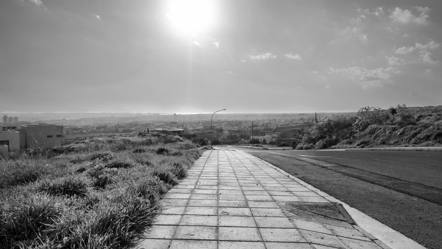 Sky Nature Sunlight Cloud - Sky Day No People Transportation Direction Road Plant The Way Forward Environment Outdoors Tranquil Scene Scenics - Nature Tranquility Sun Footpath Lens Flare Landscape Blackandwhite Black & White Landscapes EyeEm EyeEm Best Shots