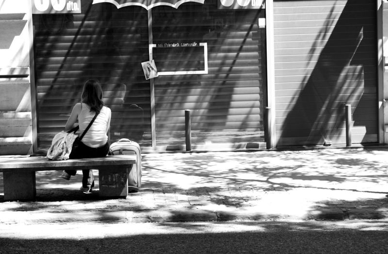 I think this young woman was from some North European country; she was visibly enjoying just sitting in the sun. City Explorer Enjoying Life Enjoying The Sun Just Arrived!! Suitcase Traveller Waiting Weekend Activities Weekend Away Weekend Getaway Woman Alone City Story The Street Photographer - 2016 EyeEm Awards People And Places Monochrome Photography Embrace Urban Life The City Light