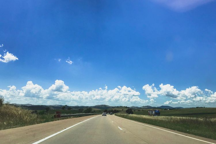 Wide open road Road The Way Forward Transportation Road Marking Sky Diminishing Perspective Landscape Cloud - Sky Blue Day Dividing Line No People Journey Outdoors Nature Scenics Mountain Beauty In Nature