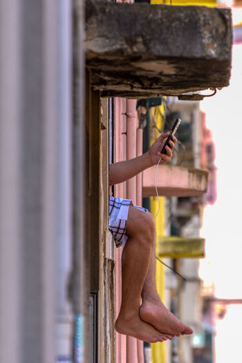 Side view of man skateboarding on metal