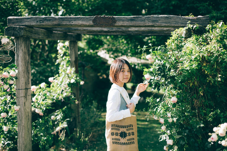 Plant One Person Real People Casual Clothing Standing Leisure Activity Day Lifestyles Growth Child Nature Childhood Waist Up Focus On Foreground Three Quarter Length Women Flower Tree Outdoors Hairstyle Innocence Girl Portrait