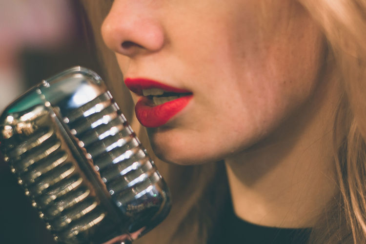 Close-Up Of Young Woman With Vintage Microphone