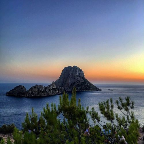 Es Vedra is claimed to be one of the best UFO sightseeing destinations in the world.nature Tranquil Scene Horizon Over Water Beauty In Nature Water Tranquility Scenics Sky Clear Sky Outdoors No People Sunset Day Sea Nature The Week Of Eyeem Tourism Ibiza Es Vedrá San Antonio Ibiza Photography Oziref Picoftheday Travel Destinations EyeEm Best Shots EyeEm Best Edits