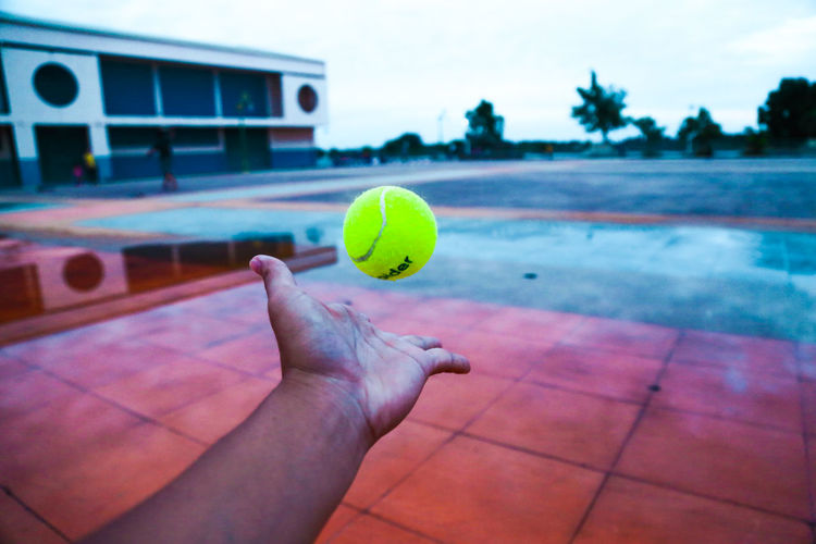 Person hand holding ball