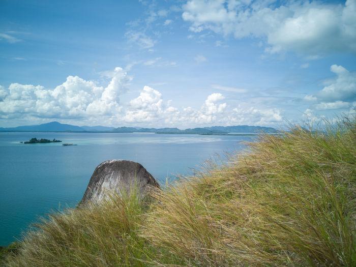 Stunning view and beautiful tropical island hillside overlooking sea at Sirongol Hill in Timbun Mata Island, Semporna, Sabah Malaysia. Semporna Sabah Malaysia Hills Trekking Landscape Adventure