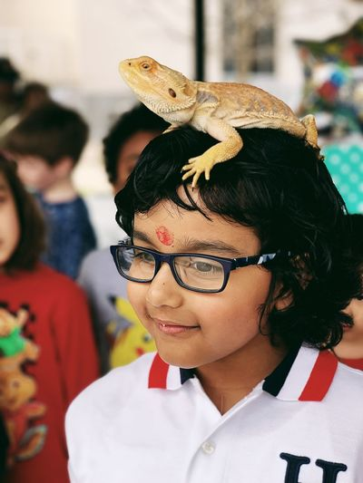 Reptile love Headshot Portrait Real People One Person Focus On Foreground Incidental People Women Looking Away Leisure Activity Females Child Day Adult Girls Hairstyle Childhood Lifestyles Close-up Looking