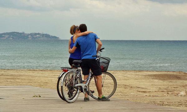 Couple embraced cyclist