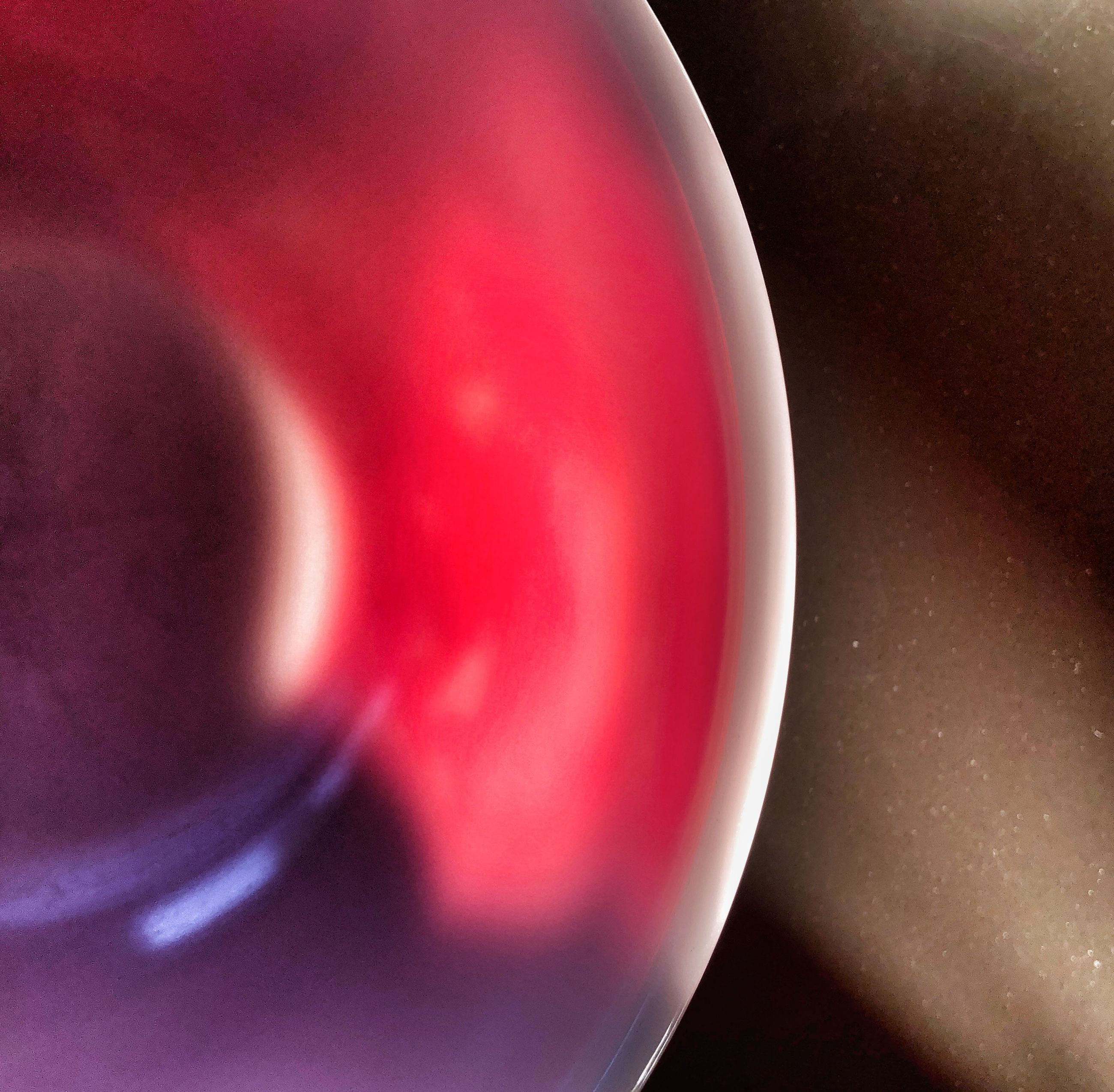 close-up, no people, indoors, red, still life, technology, food and drink, cup, detail, mug, refreshment, shape, high angle view, extreme close-up, motion, single object, pink color, drink, abstract, science, crockery