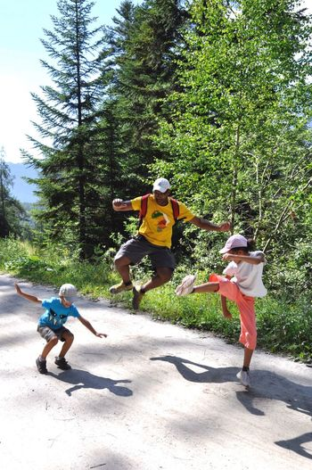 Dad And Childrens Joy Fun Tree Full Length Childhood This Is Family Family Real People Leisure Activity Day