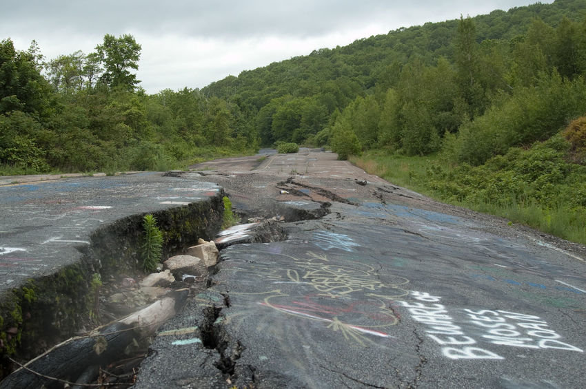 Centralia, Pennsylvania, section of road PA 61 that had to be abandoned because of the mine fire. In 1962, a fire in a dump trash put fire to the coal seam under the village. Being impossible to be put out, the fire has burnt for decades, forcing the village to be abandoned in 1982. Abandoned Centralia Coal Fire PA 61 Road