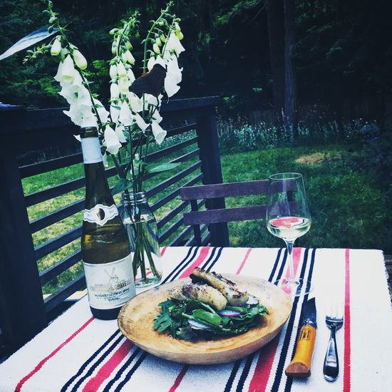 Grilled cod on salad of local kale, spinach, dandelion, red butter lettuce, purple radish and grilled asparagus. Food Al Fresco