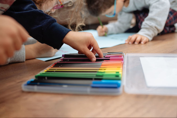 Children drawing on paper at home