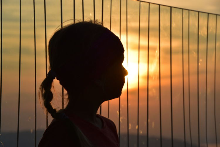 Portrait of young woman looking at sunset