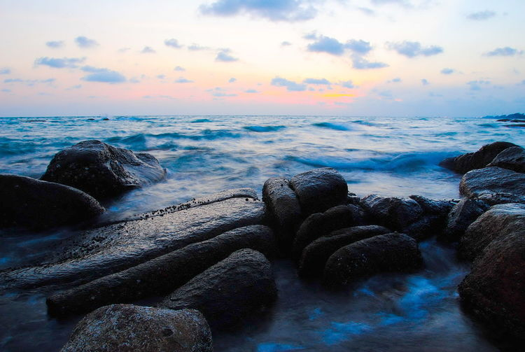 Water Sea Sky Scenics - Nature Beauty In Nature Rock Sunset Cloud - Sky Solid Rock - Object Horizon Over Water Beach Nature Tranquility Land Motion Tranquil Scene No People Idyllic Outdoors Flowing Water Rocky Coastline Evening Twilight Bay