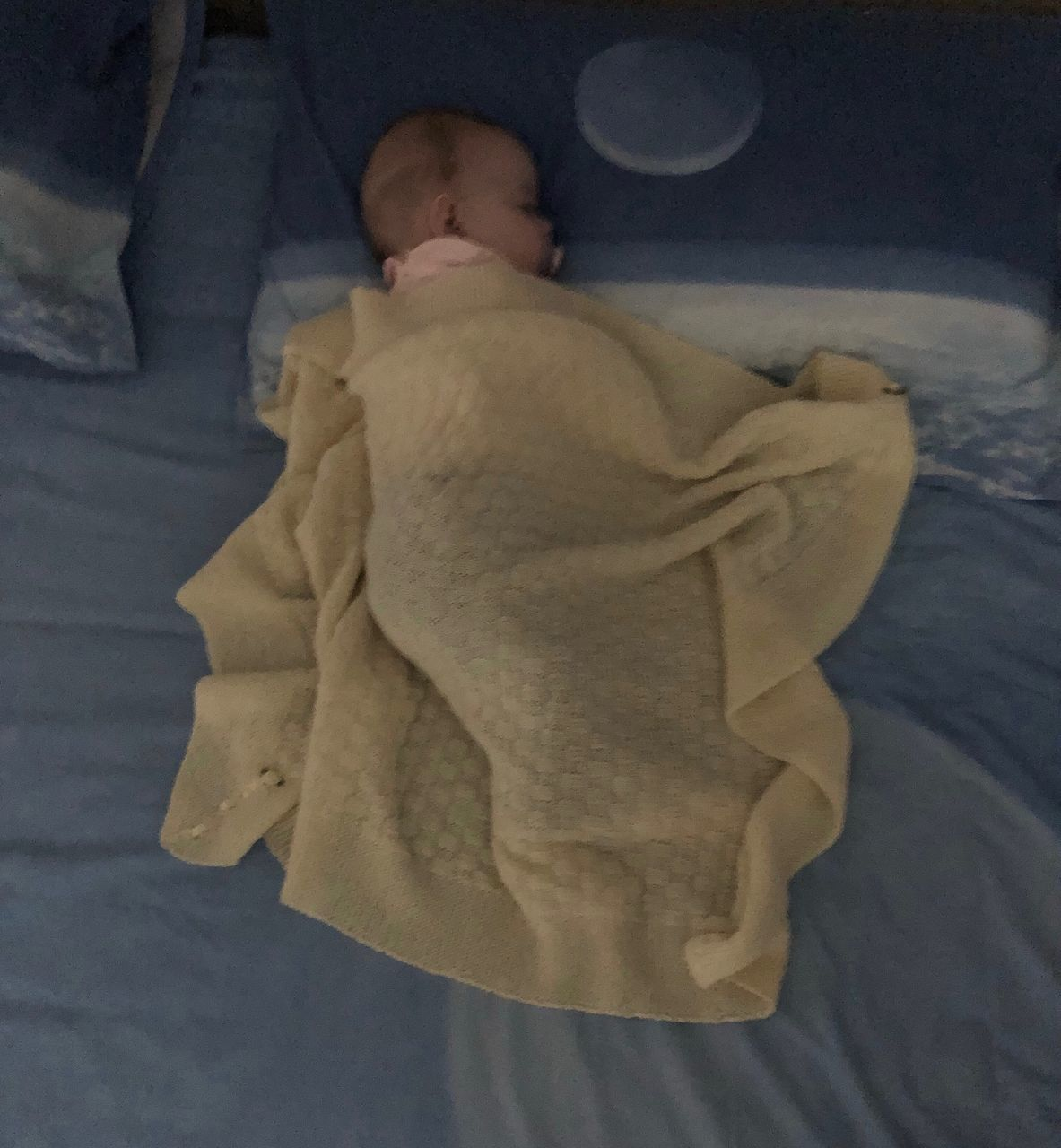LOW SECTION OF CHILD LYING IN BED