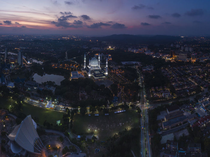 An aerial view during blue hour in Shah Alam Building Exterior Architecture Built Structure City Cityscape Illuminated Sky High Angle View Cloud - Sky Building Crowded Crowd Night Nature Sunset Residential District Aerial View Travel Destinations Outdoors