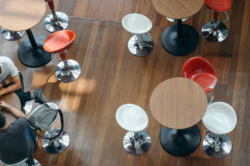 Take A Break After Office Hours Discussion Meetings Table High Angle View Indoors  Wood - Material Food And Drink Setting Still Life Arrangement Cafe Table And Chairs View From Above High Tea Time Seats Lobby Foyer Bistro Wood Flooring Round Table Indoors